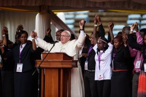 Pope Francis asked East African youth to join hands and avoid tribalism at Kasarani stadium in Nairobi on 27 November 2015. He spoke on the themes of tribalism, radicalization and corruption. Pope Francis is on a five-day visit to Kenya, Uganda and Central African Republic (CAR). AFP PHOTO/Jennifer Huxta