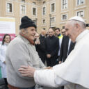 Pope Francis greets a man after making a surprise visit Nov. 16 to the medical tents set up just outside St. Peter's Square at the Vatican. Volunteer doctors, nurses and technicians were offering medical exams, tests and treatment to the poor throughout the week leading up to the World Day of the Poor, Nov. 19. (CNS photo/L'Osservatore Romano)